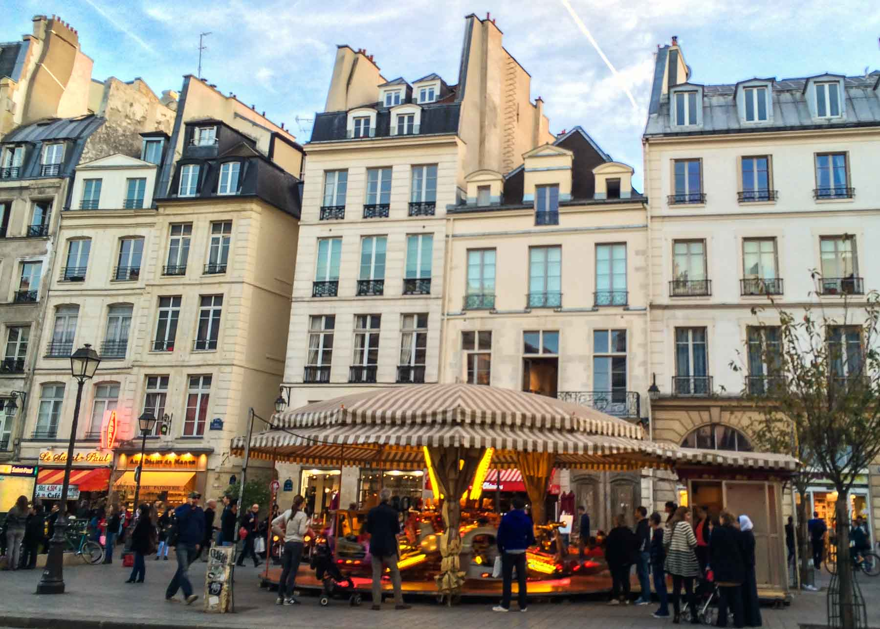 Paris apartment buildings behind a carousel.