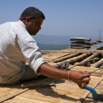 Fastening the bamboo chachra to the roof