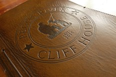 Pecos River Cliff House logo on leather journal - Earthworks Journals