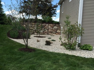 River Rock in Landscape Beds