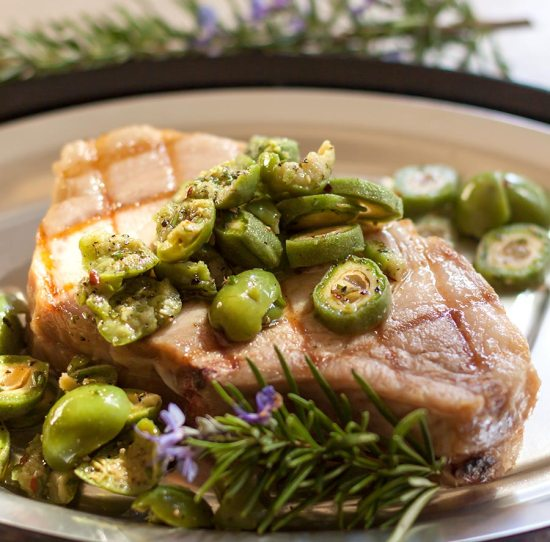 Grilled Pork Chop with Green-Almond and Olive Relish