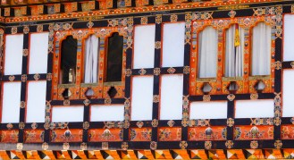 Extravagantly painted windows of a home in Bhutan