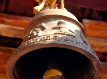 Ancient bell with intricate engraving in Malayalam