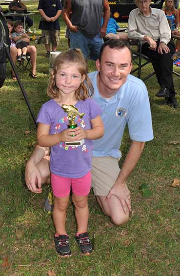 Most Fish girls ages 2-4 Kenley McLean pictured with Councilman Chris Loar.  Photo by Teri Henry