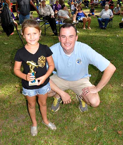 Most Fish girls ages 5-7 Kaylyn Carter pictured with Councilman Chris Loar.  Photo by Teri Henry