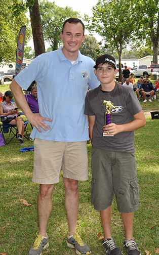 Biggest Fish ages 11-14 Brennen Deville pictured with Councilman Chris Loar.  Photo by Teri Henry