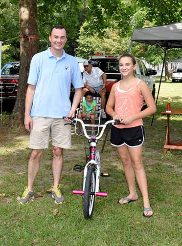 Bicycle Winner girls ages 5-14 Carson Dennis pictured with Councilman Chris Loar.  Photo by Teri Henry
