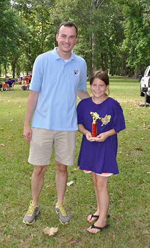 Most Fish girls ages 8-10 Elizabeth Kennison pictured with Councilman Chris Loar.  Photo by Teri Henry