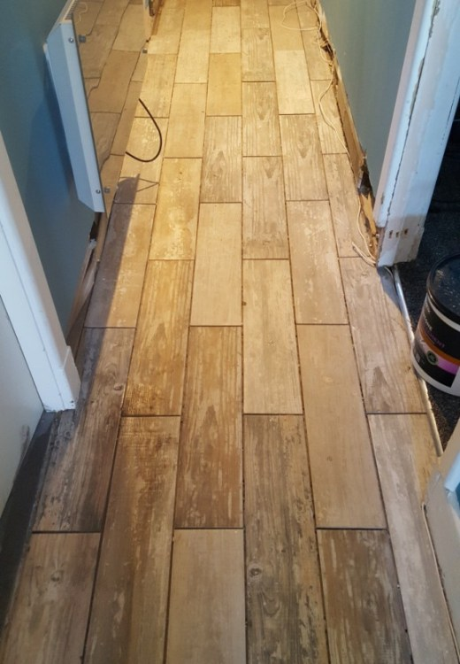 Porcelain wood effect tiles before grouting in Holmes Chapel