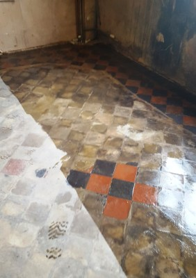 Red and Black Quarry Tiled Kitchen Floor Covered in Screed During Cleaning in Mobberly