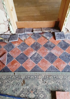 Red and Black Quarry Tiled Kitchen Floor Showing Damaged Tile Section in Mobberly