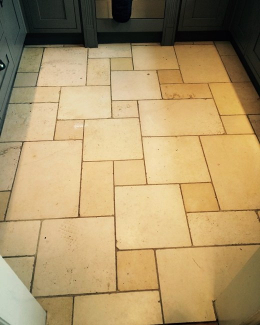 Limestone kitchen floor before cleaning in Hartfield
