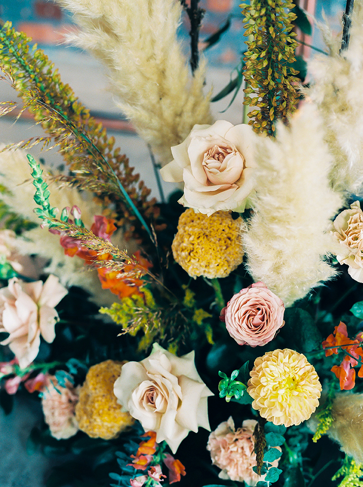 boho flower arrangement of roses and greenery