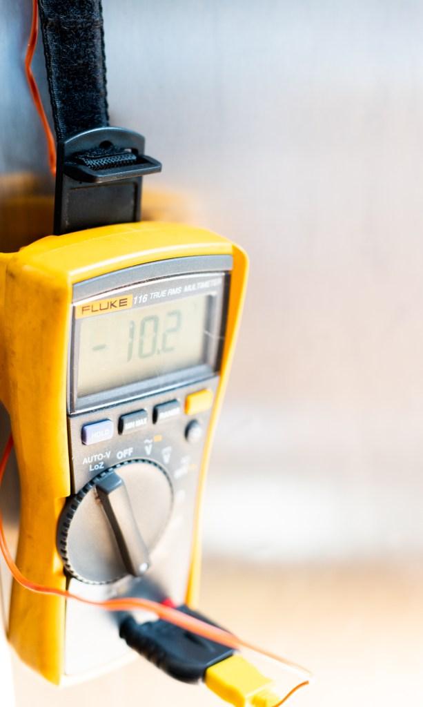 Fluke Digital Meter reading 10.2 degrees on home refrigerator