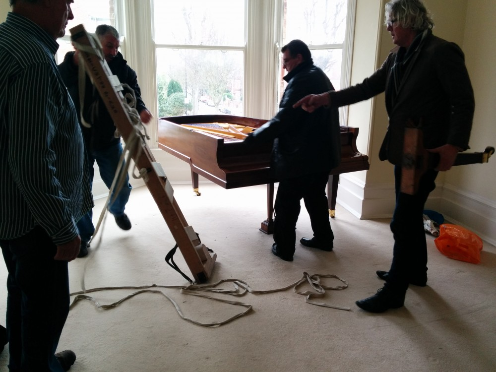 Grand piano almost in place