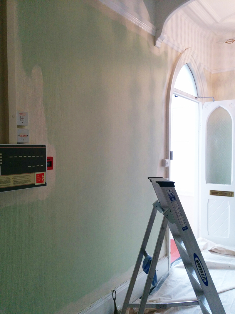 Painting the communal hall walls