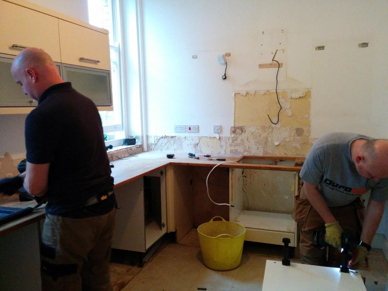Ev & Vince at work kitchen stripping