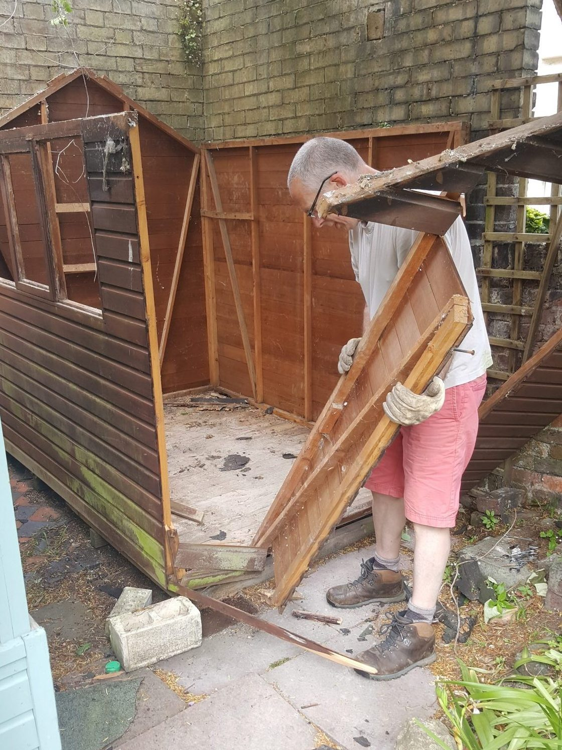 taking the front off the old shed