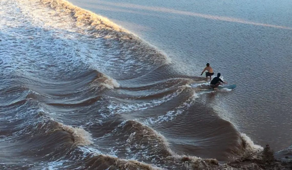 East Coast Mermaid Surfing the tidal bore