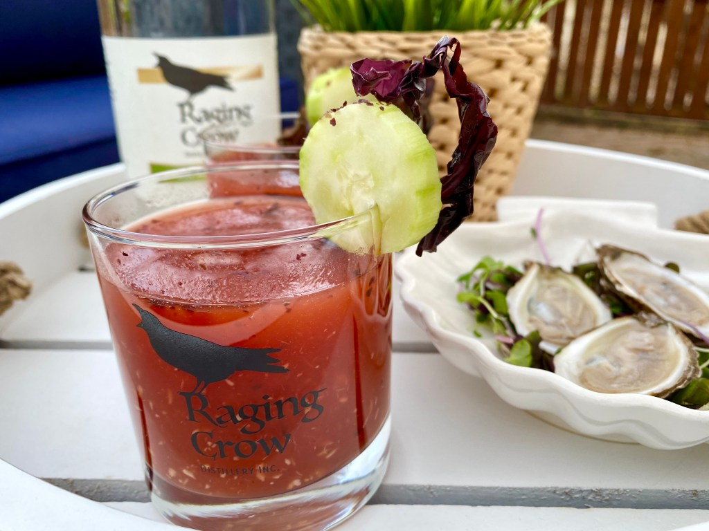 An East Coast Mermaid Caesar next to a plate of Atlantic Canadian Oysters