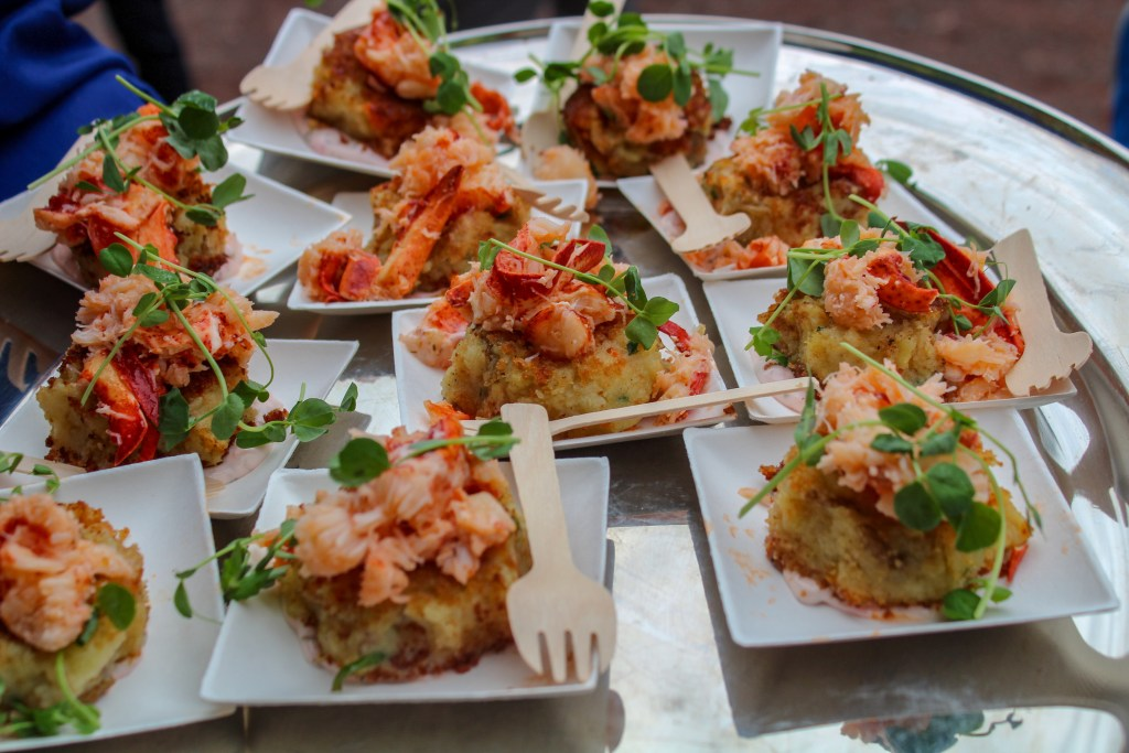 panko crusted potato cake topped with lobster and served on a lemon seaweed remoulade.