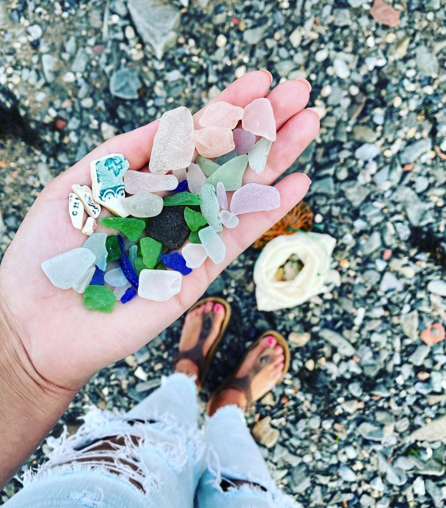 Crystal Richard of East Coast Mermaid holding a handful of seaglass during Campobello Island Seaglass Festival