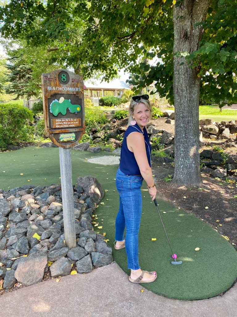Crystal Richard playing a round of mini putt at Mariner's Cove Mini Putt in Cavendish