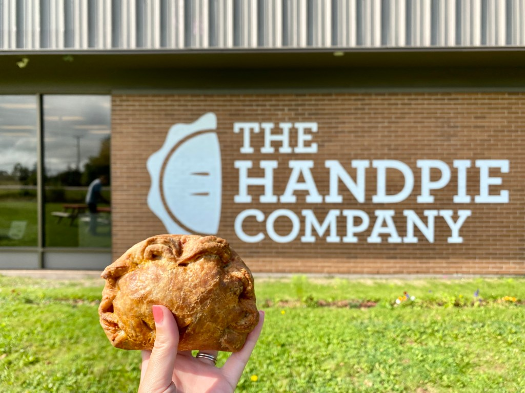 A photo of a hand pie in front of The Handpie Company in Prince Edward Island.