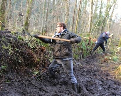 Mud monsters - Matt and Jose digging the dirt