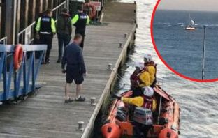 The catamaran ran aground on Pole Sands, Exmouth, and police spoke with the two men who were on board the vessel. Main photo courtesy of Rob Vince/RNLI. Inset image by Lynne Tregenna Wood.