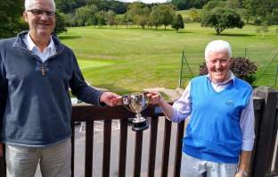 Sidmouth club captain Lester Wilmington (left) presents John Arnott with the Veterans Cup. Picture: Sidmouth Golf Club
