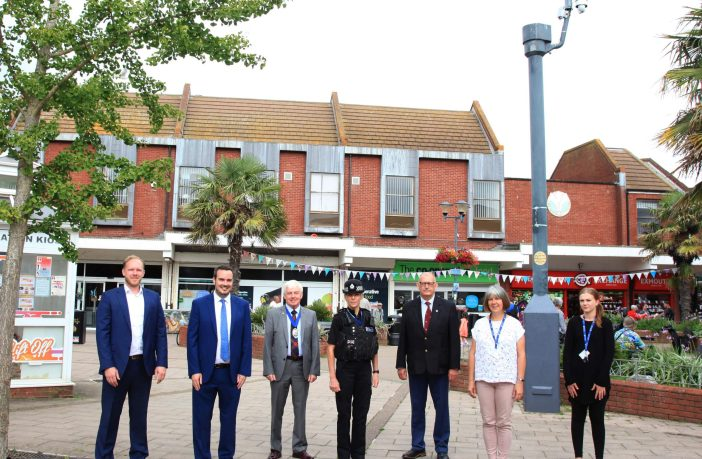 Pictured (l-r) in front of one of the CCTV cameras sited at the Magnolia Centre are: Ross Johnstone of Wireless CCTV Ltd; East Devon MP; County council chairman Jeff Trail; Inspector Antonia Weeks from Devon and Cornwall Police; Councillor Fred Caygill and Lisa Bowman and Mollie Carey from Exmouth Town Council. Image courtesy of the town council