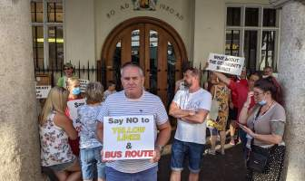 Protester Malcolm Stone outside of Exeter Guildhall before the plans were discussed.