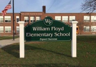 Wm Floyd Elementary carved sign
