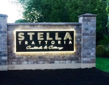 Stella Trattoria illuminated sign