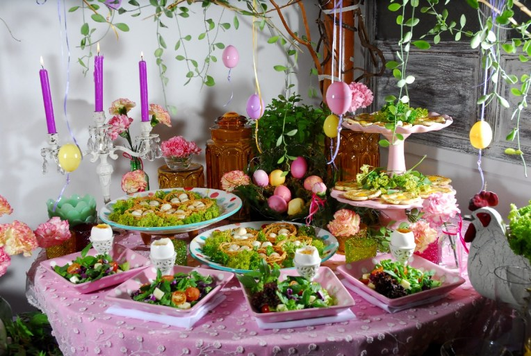 http://pureps.com/wp-content/uploads/2015/07/easter-sunday-brunch-table-decor_buffet-setting_white-egg-holder_pink-flower-pattern-tablecloth_pink-cupckae-stand_pink-polka-dot-serving-plate_hanging-egg-ornament_white-candle-holder.jpg