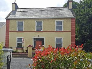 This is the house in Ballinasloe (County Galway) that the author's grandmother grew up in.  Known as the big yellow house in Ballinasloe., it is for sale as of summer 2018.  It needs some TLC.