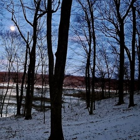 Full moon on snow illuminates an evening hike