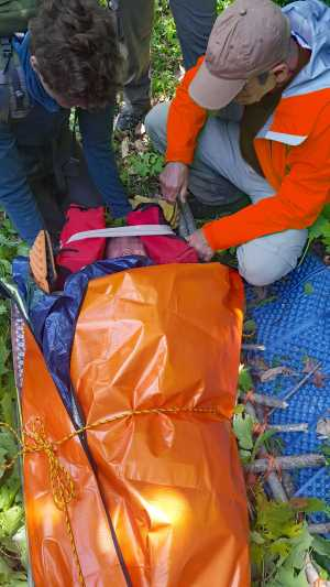 """Keeping a """"patient"""" warm in  Wilderness First Aid class."""