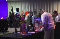 ESLT guests and board members contemplating the wide array of auction items.