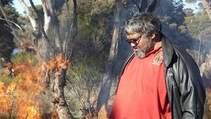 Ngadju Conservation Coordinator Les Schultz near a traditional burn