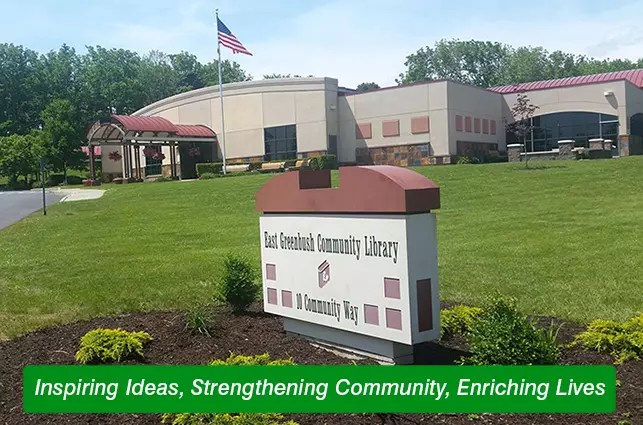 "Library building captioned ""Inspiring Ideas, Strengthening Community, Enriching Lives"""