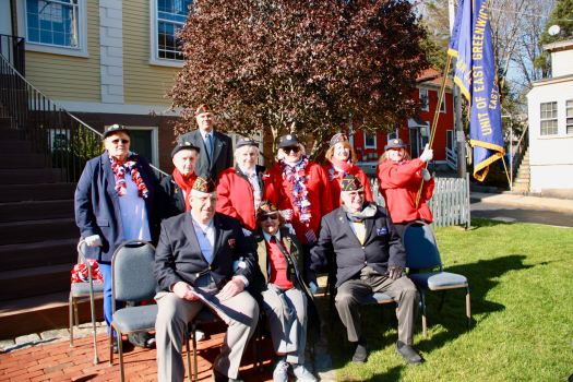 This year's Veterans Day Parade Grand Marshal, Lucy Amat, chaplain of the American Legion Post 15, surrounded by her fellow members.