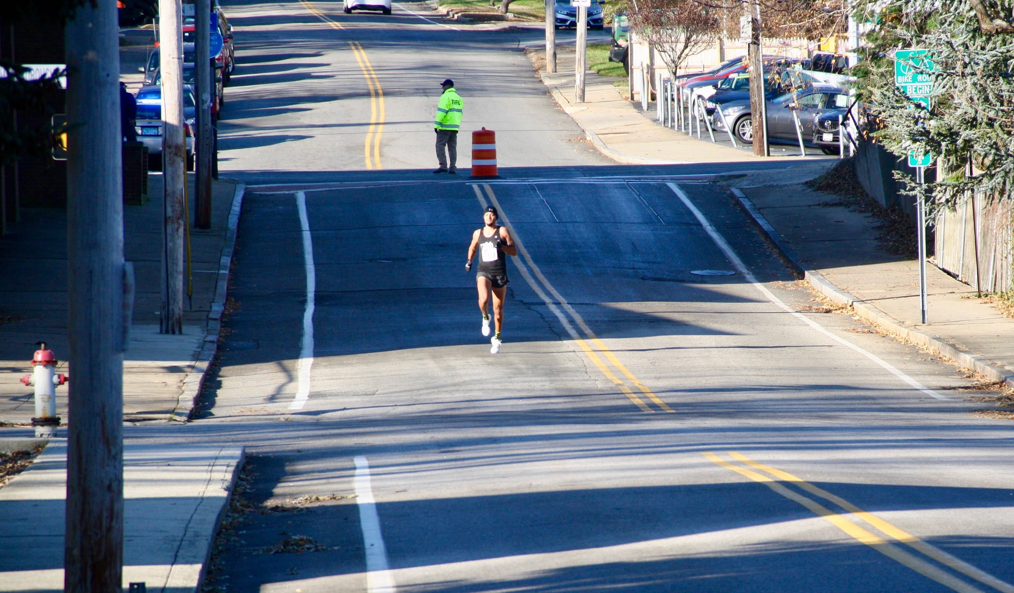 Alone at the front, Bronson Venable heads down Division Street to the final turn. Venable won the race with a time of 15:16.