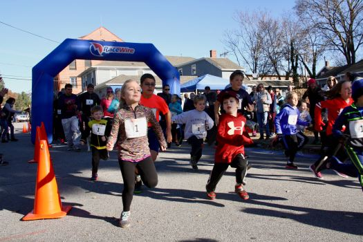 Running hard at the start of the Turkey Trot Fun Run.