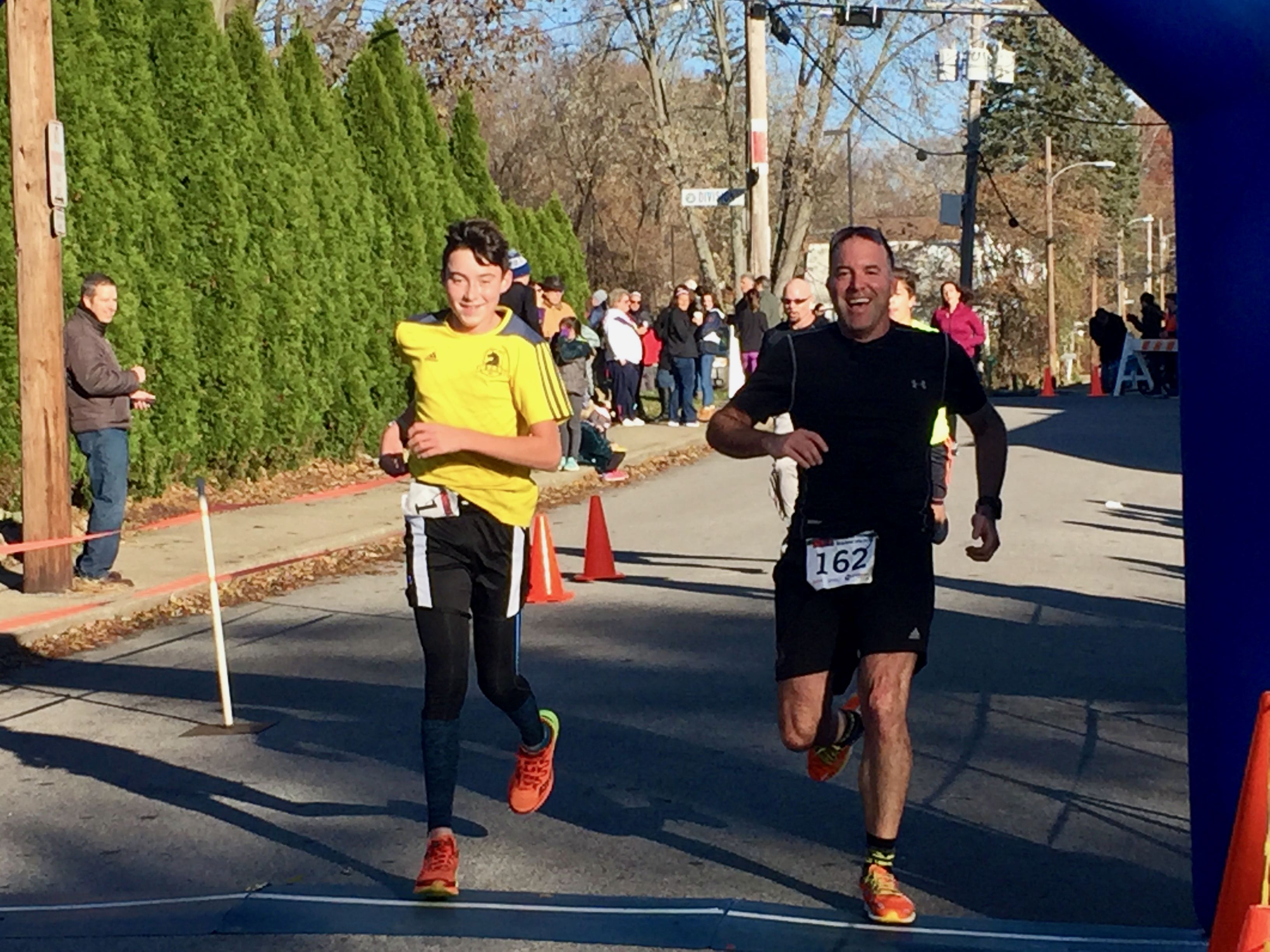 Jeremy and Joshua Jarbeau cross the finish line.