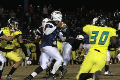#1 Stevie Williams/QB scrambles out of pocket to find receiver downfield.
