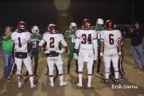 Team Co-Captains meet with officials for coin toss.