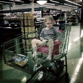 Sitting in her thrown in her cart
