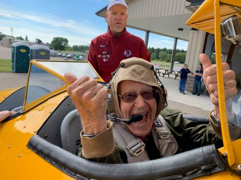 WWII Veteran Lew Harned celebrates his landing with a thumbs up